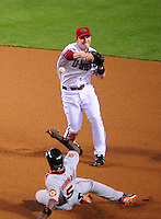 Apr. 21, 2008; Phoenix, AZ, USA; Arizona Diamondbacks shortstop Stephen Drew throws to first base to complete the double play after forcing out San Francisco Giants base runner Ray Durham in the seventh inning at Chase Field. Mandatory Credit: Mark J. Rebilas-