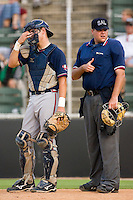 Rome Braves catcher Braeden Schlehuber #23 and home plate umpire Ryan Carle at Fieldcrest Cannon Stadium July 26, 2009 in Kannapolis, North Carolina. (Photo by Brian Westerholt / Four Seam Images)