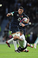 Nathan Hughes of England looks for support as he is tackled by Josh Matavesi of Fiji during the Old Mutual Wealth Series match between England and Fiji at Twickenham Stadium on Saturday 19th November 2016 (Photo by Rob Munro)