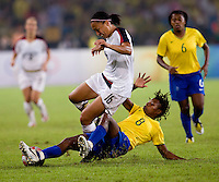 Angela Hucles, Formiga. The USWNT defeated Brazil, 1-0, to win the gold medal during the 2008 Beijing Olympics at Workers' Stadium in Beijing, China.