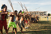Indigenous warriors point their arrows at the Congress building during a demonstration in Brasilia, Brazil by the Xicrin, Kayapo and Pataxo tribes, 10th November 2015. Photo © Sue Cunningham, pictures@scphotographic.com