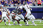 TCU Horned Frogs defensive end Josh Carraway (94) and Samford Bulldogs running back Denzel Williams (25) in action during the game between the Samford Bulldogs and the TCU Horned Frogs at the Amon G. Carter Stadium in Fort Worth, Texas.  TCU leads Stamford 24 to 7 at halftime.