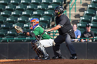 Savannah Sand Gnats catcher Adrian Abreu (24) sets a target as home plate umpire Randy Collins looks on during the South Atlantic League game against the Hickory Crawdads at L.P. Frans Stadium on June 14, 2015 in Hickory, North Carolina.  The Crawdads defeated the Sand Gnats 8-1.  (Brian Westerholt/Four Seam Images)