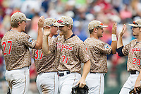 Virginia Cavaliers outfielder Joe McCarthy (31) celebrates with pitcher Josh Sborz (27) after beating the Arkansas Razorbacks in Game 1 of the NCAA College World Series on June 13, 2015 at TD Ameritrade Park in Omaha, Nebraska. Virginia defeated Arkansas 5-3. (Andrew Woolley/Four Seam Images)