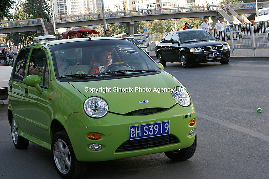 "A cute ""QQ"" Chery is seen in downtown Beijing, China. The private owned automobile company based in Anhui province has make a great success in producing economical & environmental friendly small cars.."