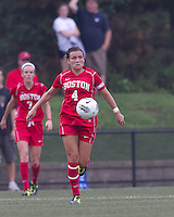 Boston University midfielder Brittany Heist (4) controls the ball. After 2 complete overtime periods, Boston College tied Boston University, 1-1, after 2 overtime periods at Newton Soccer Field, August 19, 2011.