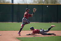 Arizona Diamondbacks second baseman Yan Sanchez (14) leaps over Camden Duzenack (3) on a stolen base attempt during a Minor League Spring Training intrasquad game at Salt River Fields at Talking Stick on March 12, 2018 in Scottsdale, Arizona. (Zachary Lucy/Four Seam Images)