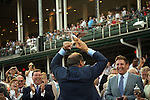 June 13, 2015 Ahmed Zayat of Zayat Stables holds (on his head) the Triple Crown winner's trophy for American Pharoah, who won the 2015 running of the first jewel of the Triple Crown at Churchill Downs.  ©Mary M. Meek/ESW/CSM