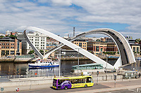 Newcastle-upon-Tyne & Gateshead, England, UK.  Millennium Bridge, a pedestrian tilt-bridge over the River Tyne.