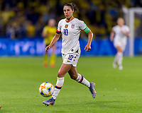 LE HAVRE,  - JUNE 20: Carli Lloyd #10 runs onto the ball during a game between Sweden and USWNT at Stade Oceane on June 20, 2019 in Le Havre, France.