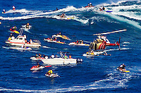 A helicopter filming tow-in surfing at Peahi (Jaws) off Maui. Hawaii.<br />