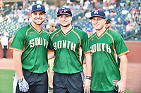 Chad Spanberger of the Asheville Tourists poses with his team mates Casey Golden and Bret Boswell after winning the home run derby as part of the All Star Game festivities at First National Bank Field on June 19, 2018 in Greensboro, North Carolina.(Tony Farlow/Four Seam Images)