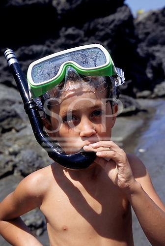 Osa Peninsula, Costa Rica. Boy snorkelling on the beach.