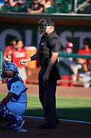 Umpire Pete Talkington handles the calls behind the plate during the game between the Ogden Raptors and the Orem Owlz at Lindquist Field on June 19, 2018 in Ogden, Utah. The Raptors defeated the Owlz 7-2. (Stephen Smith/Four Seam Images)