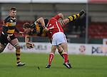 Andrew Coombs (Capt) gets tackled. Newport V Llanelli, Principality Premiership. © Ian Cook IJC Photography iancook@ijcphotography.co.uk www.ijcphotography.co.uk