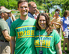 """May 31, 2014; Two 1994 alums wear the original version of """"The Shirt"""" for the 2014 Reunion class photo. The Shirt was first offered in the freshman year of the class of '94. Photo by Matt Cashore/University of Notre Dame"""