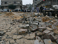 "Palestinain walk along destroyed road after isreal withdarwal from gaza strip.March.03.2008.""phto by Fady Adwan"""