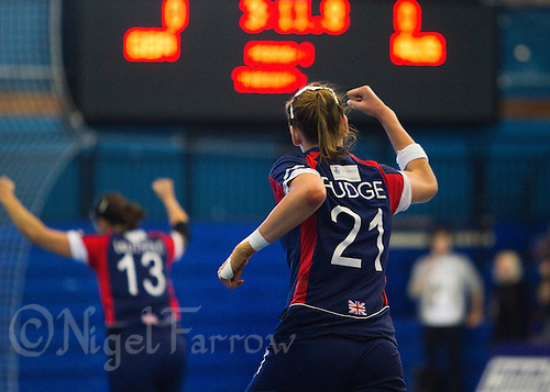 22 OCT 2011 - LONDON, GBR - Britain's Kathryn Fudge (#21 - blue and red) celebrates scoring the first goal of the teams Women's 2012 European Handball Championship qualification match against Russia at the National Sports Centre at Crystal Palace .(PHOTO (C) NIGEL FARROW)