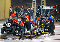 Jul 19, 2019; Morrison, CO, USA; NHRA top fuel driver Leah Pritchett with crew members during qualifying for the Mile High Nationals at Bandimere Speedway. Mandatory Credit: Mark J. Rebilas-USA TODAY Sports