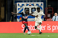 FOXBOROUGH, MA - AUGUST 5: Edward Kizza #19 of New England Revolution II dribbles as Malick Mbaye #5 of North Carolina FC pressures during a game between North Carolina FC and New England Revolution II at Gillette Stadium on August 5, 2021 in Foxborough, Massachusetts.