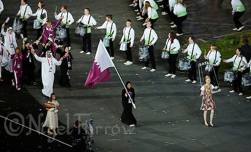 27 JUL 2012 - LONDON, GBR - Shooting competitor Bahya Mansour Al Hamad (QAT) leads the team from Qatar around the Olympic Stadium during the Opening Ceremony of the London 2012 Olympic Games in Stratford, London, Great Britain .(PHOTO (C) 2012 NIGEL FARROW)