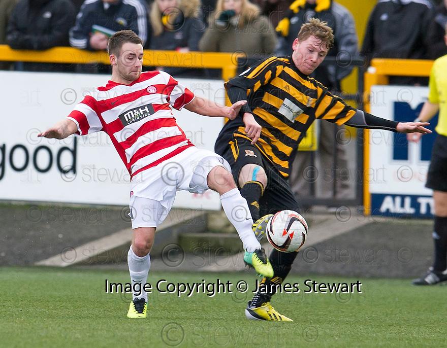 Hamilton's James Keatings and Alloa's Michael Doyle challenge for the ball.