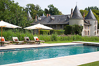 Tucked away behind hedges is a modern addition to the chateau in the shape of a contemporary swimming pool