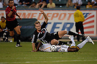 Los Angeles Galaxy's Edson Buddle gets knocked down by D.C. United Bryan Namoff at the Home Depot Center in Carson, CA on Wednesday, August 15, 2007. The Los Angeles Galaxy defeated D. C. United 2-0 in a SuperLiga semifinal match.