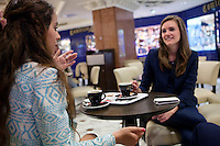Diana Basfam (left) and Stefanie A (right), students of the International University of Monaco, drink coffee in Lina's Café in the Métropole Shopping Centre, Monte Carlo, Monaco, 19 April 2013