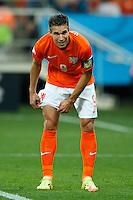 Robin van Persie of the Netherlands pulls his socks up