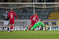 27th March 2021; Dens Park, Dundee, Scotland; Scottish Championship Football, Dundee FC versus Dunfermline; Dundee goalkeeper Adam Legzdins gets down to save a deflected shot from Ewan Henderson of Dunfermline Athletic
