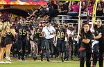 Florida State head coach Willie Taggart leads his team onto the field against Virginia Tech prior to an NCAA college football game in Tallahassee, Fla., Monday, Sept. 3, 2018. Virginia Tech defeated Florida State 24-3.  (AP Photo/Mark Wallheiser)