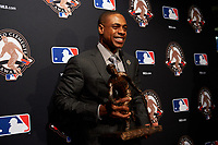 Curtis Granderson poses for photos during the presentation of the Roberto Clemente Award before Game 3 of the Major League Baseball World Series between the Cleveland Indians and Chicago Cubs on October 28, 2016 at Wrigley Field in Chicago, Illinois.  (Mike Janes/Four Seam Images)