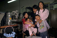 San Donnino.Firenze..Laboratorio di pelletteria dove lavorano immigrati cinesi.Chinese immigrants work in a leather Laboratory....