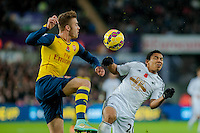 Sunday 9th November 2014<br /> Pictured: ( L-R ) Calum Chambers of Arsenal and Jefferson Montero of Swansea City<br /> Re: Barclays Premier League Swansea City v Arsenal at the Liberty Stadium, Swansea, Wales,UK