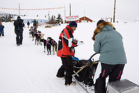 Elim checker Carl Paul checks in Rick Swenson as he pulls into Elim on Tuesday afternoon during Iditarod 2008