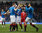 Jon Daly is mobbed after rising to put Rangers two up