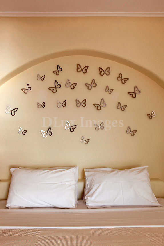 Bed headboard decorated with butterflies