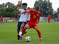 3rd September 2021; Newport, Wales:  Cian Ashford of Wales is challenged by Jadel Katongo of England during the U18 International Friendly  match between Wales and England at Newport Stadium in Newport, Wales.