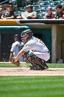Rafael Lopez (17) of the Salt Lake Bees warms up the pitcher between innings against the El Paso Chihuahuas at Smith's Ballpark on July 26, 2015 in Salt Lake City, Utah. El Paso defeated Salt Lake 6-3 in 10 innings.(Stephen Smith/Four Seam Images)