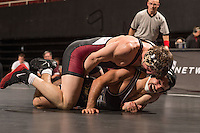 STANFORD, CA - January 18, 2015: Garrett Schaner of the Stanford Cardinal wrestling team competes during a meet against Cal Poly at Maples Pavilion. Stanford won 22-13.