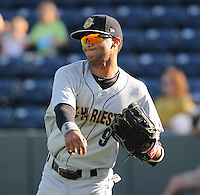 Outfielder Mason Williams (9) of the Charleston RiverDogs, a New York Yankees affiliate, prior to a game against the Greenville Drive on June 2, 2012, at Fluor Field at the West End in Greenville, South Carolina. Greenville won, 10-4. Williams is the Yankees' No. 5 prospect, according to Baseball America. (Tom Priddy/Four Seam Images)