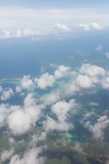 Munda, Western Province, Solomon Islands; an aerial view of the fringe islands to the east of Roviana lagoon offshore of Munda Point, with puffy white clouds overhead