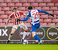 6th February 2021; Bet365 Stadium, Stoke, Staffordshire, England; English Football League Championship Football, Stoke City versus Reading; James McClean of Stoke City under pressure from Tom Holmes of Reading