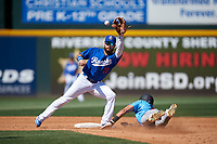 Rancho Cucamonga Quakes shortstop Jacob Amaya (25) prepares to apply the tag to Jordyn Adams (9) on a stolen base attempt during a California League game against the Inland Empire 66ers at LoanMart Field on September 2, 2019 in Rancho Cucamonga, California. Rancho Cucamonga defeated Inland Empire 4-3. (Zachary Lucy/Four Seam Images)