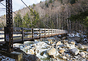Side view of foot bridge along the Dry River Trail in Cutt's Grant in the New Hampshire White Mountains. Located within the Dry River Wilderness this bridge crosses the Dry River.
