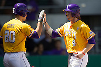 LSU Tigers outfielder Raph Rhymes #4 is greeted by teammate Chris Chinea #20 after he scores against the Auburn Tigers in the NCAA baseball game on March 24, 2013 at Alex Box Stadium in Baton Rouge, Louisiana. LSU defeated Auburn 5-1. (Andrew Woolley/Four Seam Images).