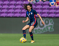 ORLANDO, FL - FEBRUARY 21: Christen Press #23 of the USWNT dribbles during a game between Brazil and USWNT at Exploria Stadium on February 21, 2021 in Orlando, Florida.