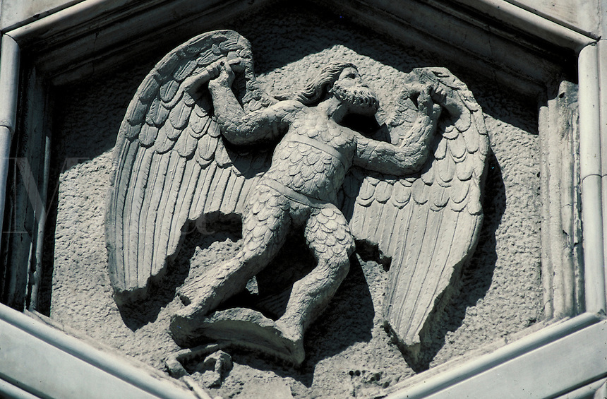 Sculptural architectural detail of Icarus-like figure. Florence Tuscany Italy Europe.