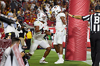 LOS ANGELES, CA - SEPTEMBER 11: Ricky Miezan #45 and Noah Williams #9 of the Stanford Cardinal react after a play during a game between University of Southern California and Stanford Football at Los Angeles Memorial Coliseum on September 11, 2021 in Los Angeles, California.
